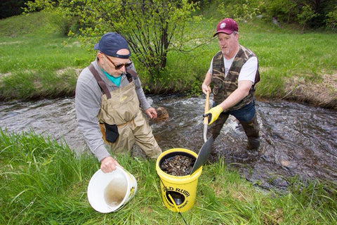 Two men panning with a Gold Rush Nugget Bucket