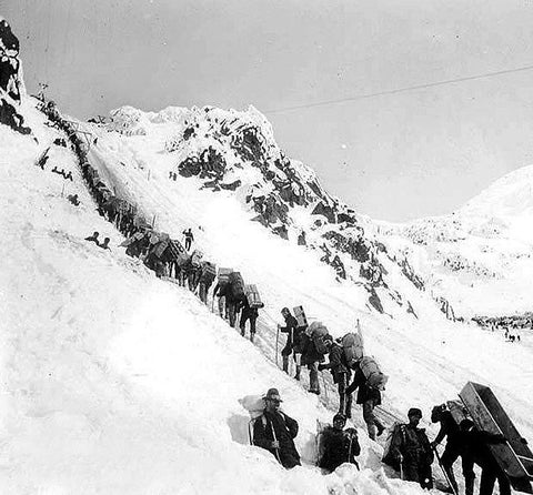 Climbers ascending the Chilkoot Pass near Klondike.