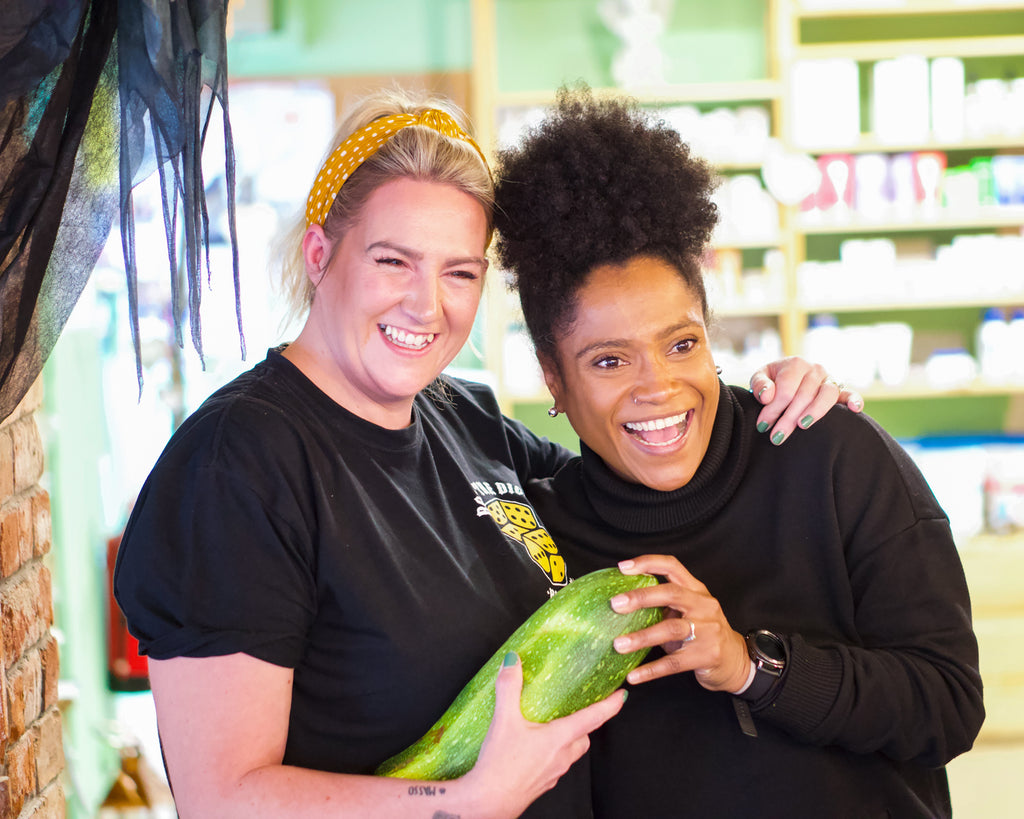 Sara Da Silva and Gina Daly pose with a large green courgette in a vegan restaurant in Co Meath Ireland