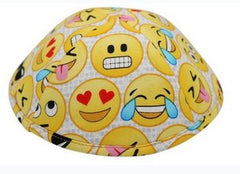 An iKIPPAH brand yarmulke with a number of fun, yellow emoji on it.