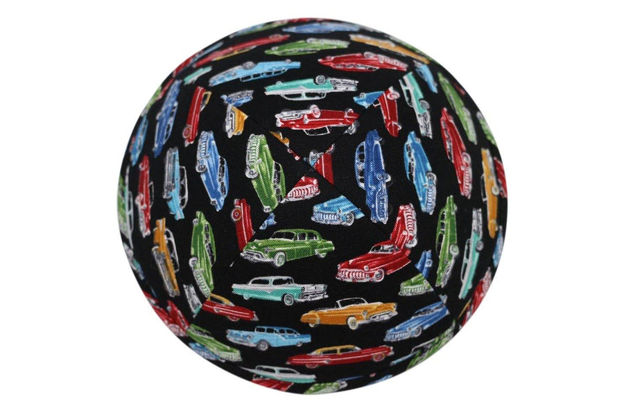 An black iKIPPAH brand yarmulke with dozens of colorful vintage cars from the 40's and 50's.