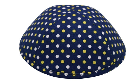 An iKIPPAH brand yarmulke with a large number of yellow & white dots on a dark blue fabric.