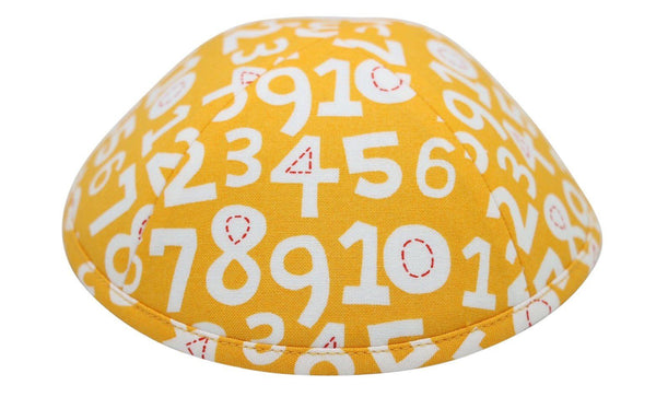 A bright yellow iKIPPAH brand yarmulke with many large white numbers from one to ten.