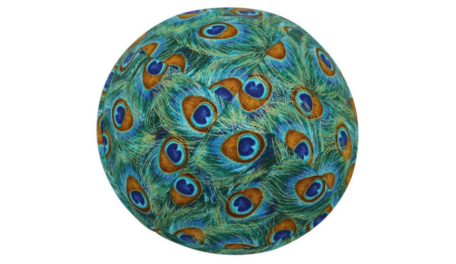 An iKIPPAH brand yarmulke that is an artist's rendition of exotic peacock feathers in shades of bright grean, blue & brown.
