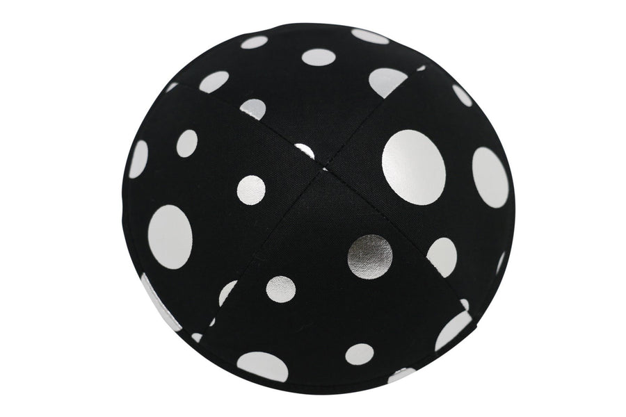 A black iKIPPAJH brand yarmulke with a number of bright silver circles on it.