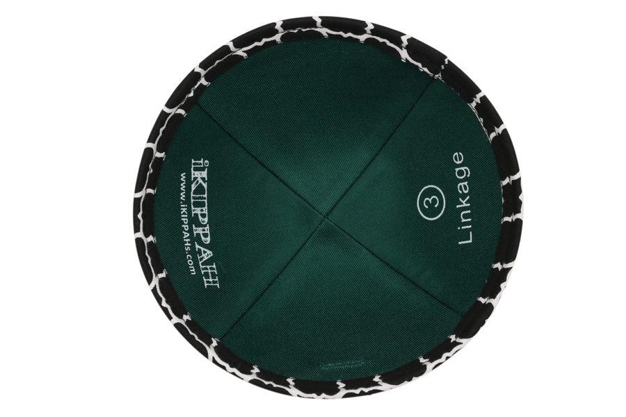 A black iKIPPAH brand yarmulke with white connected links.