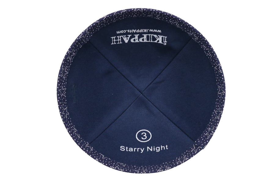 A black iKIPPAH brand yarmulke with a series of big stars and small star dots on it.