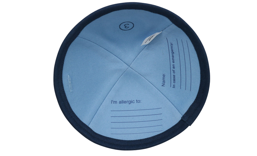 Dark blue iKIPPAH brand yarmulke with an Allergy Alert symbol and a 'flip for info' phrase to help give awareness to people's allegies.