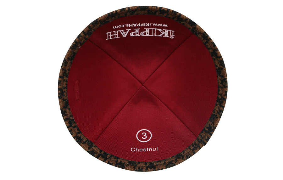 A patterned chestnut brown and black iKIPPAH brand yarmulke.