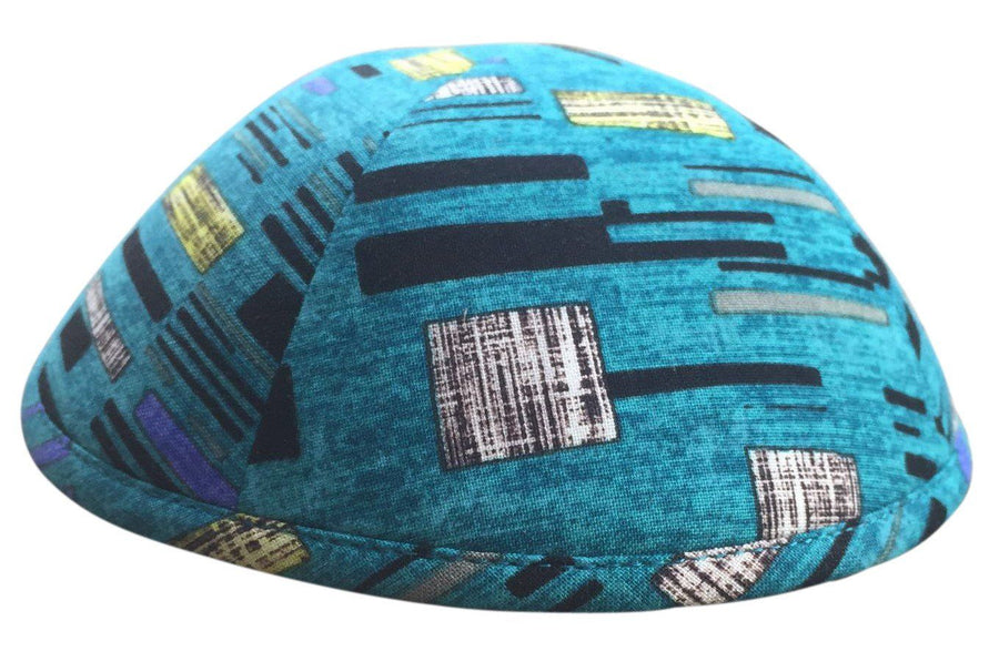 A beautiful iKIPPAH brand yarmulke in light blue with square & rectangular shapes.