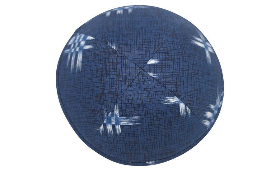 A vibrant looking blue patterned iKIPPAH brand yarmulke.