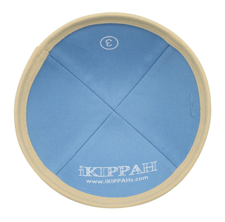 A bright light yellow linen iKIPPAH brand yarmulke.