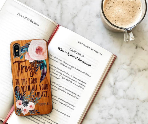 Trust in the Lord phone case on book