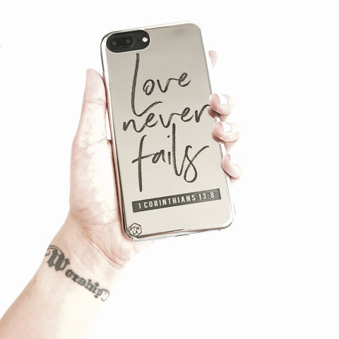 S216- Love Never Fails - Shimmer Series - Bible Verse Chrome Design Phone Case