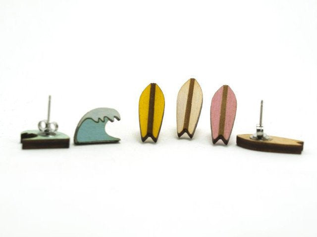 Yellow Surfboard and Wave Studs