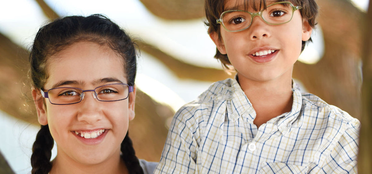 Close up of two children wearing glasses by Mr Foureyes