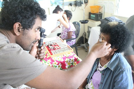 Mr Foureyes founder Ravi Dass helping on restore eyesight a charity trip in the Pacific