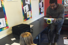 Ravi from Foureyes Foundation screening a child's eyesight at Titahi Bay School