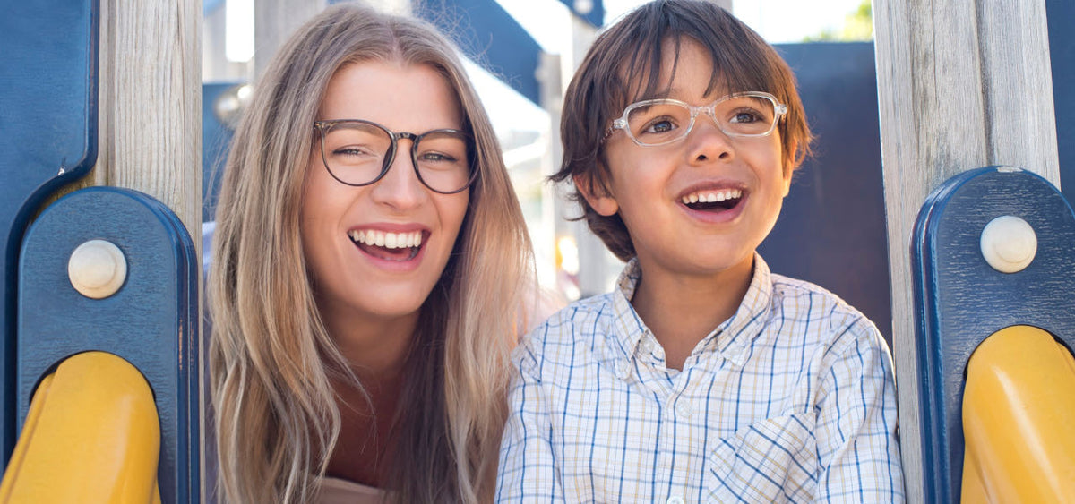 Smiling woman and child wearing Mr Foureyes glasses