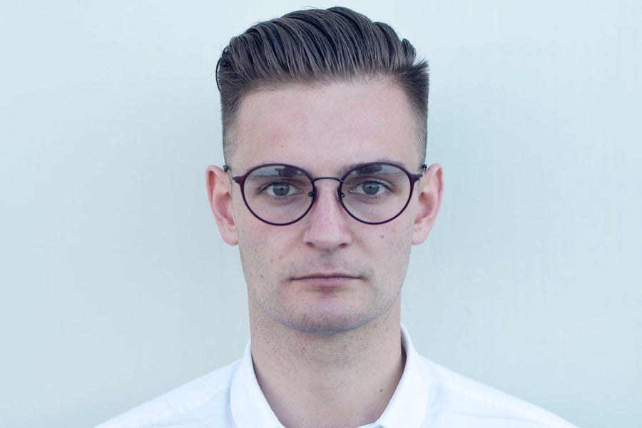 Profile shot of man wearing metal glasses frames (style 'Alexander') by Mr Foureyes