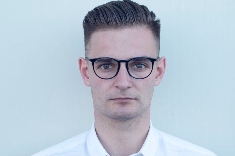 Man wearing round acetate glasses frames with keyhole detail by Mr Foureyes