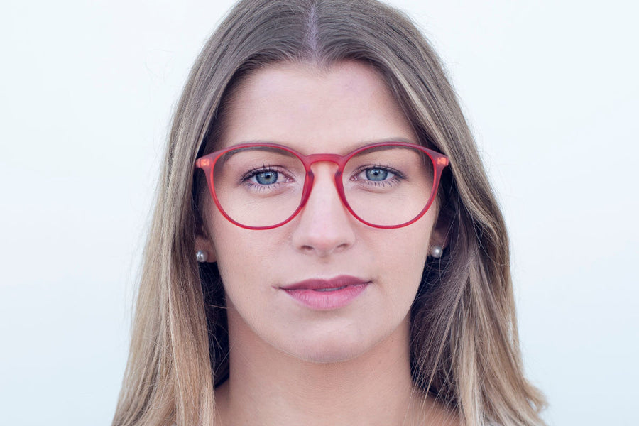 Pretty blond model wearing colourful orange, round glasses frames by Mr Foureyes