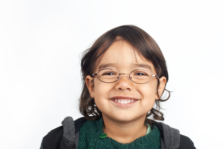 Cute young boy wearing metal children's glasses frames in bronze | Mr Foureyes