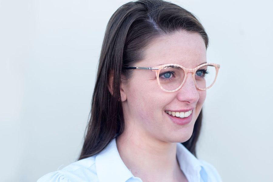 Brunette woman wearing cream-coloured metal glasses frames by Mr Foureyes