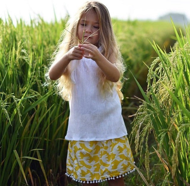 Trendy Girls Toddler Skirt mustard in colour, 100% cotton with pom pom trim