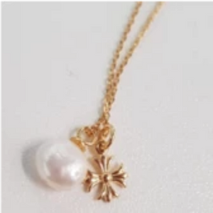 sea pearl and cross necklace
