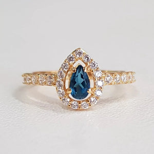 London Blue Topaz small pear shape halo design