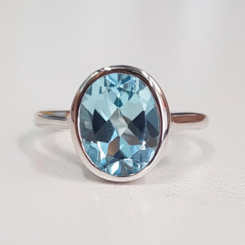 Top Sky Blue Topaz Bezel Ring