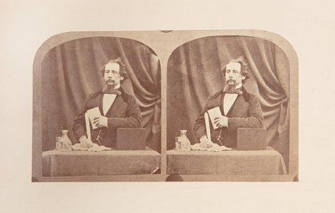 Photograph of Dickens at reading desk