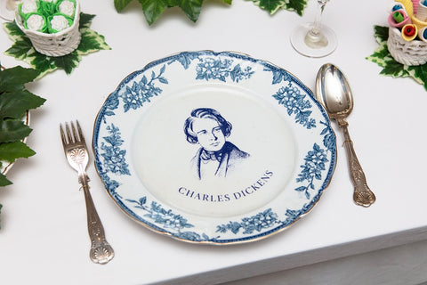 Image of place setting with plate featuring portrait of Charles Dickens