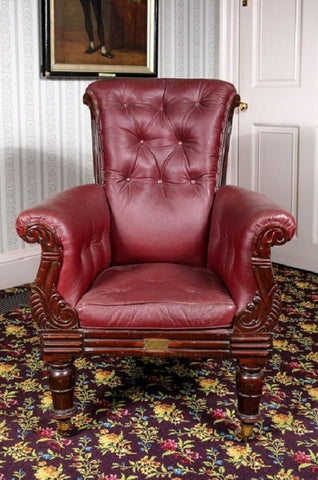 Close up of Dickens's armchair, front view