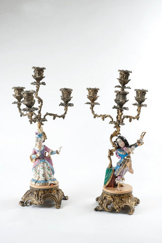 Pair of candlesticks, one with female figurine, one with male figurine