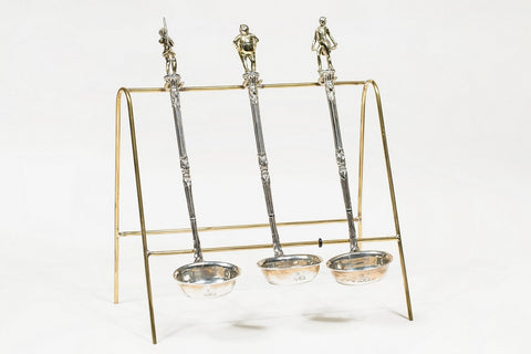 Three silver punch ladles featuring characters from The Pickwick Papers, 1837