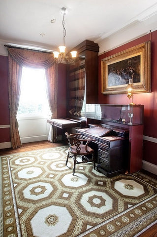 Desk and chair owned by Charles Dickens in study