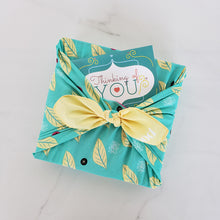 Load image into Gallery viewer, Our Kiss Naturals kit wrapped as a gift with the furoshiki cloth and card that are included