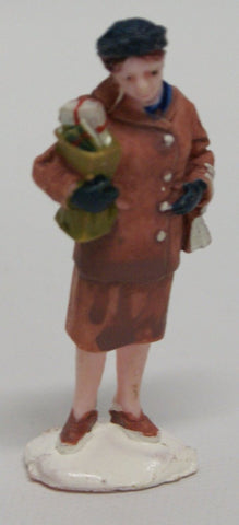 Train layout figure : Lady carrying gifts.