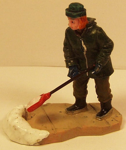 Lady shoveling snow B3229 2-1/2 in. train figure
