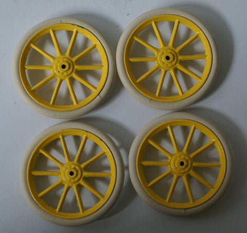 Set of Four Bing or Carette Wheels with Tire.  Yellow Cast hub with tire.