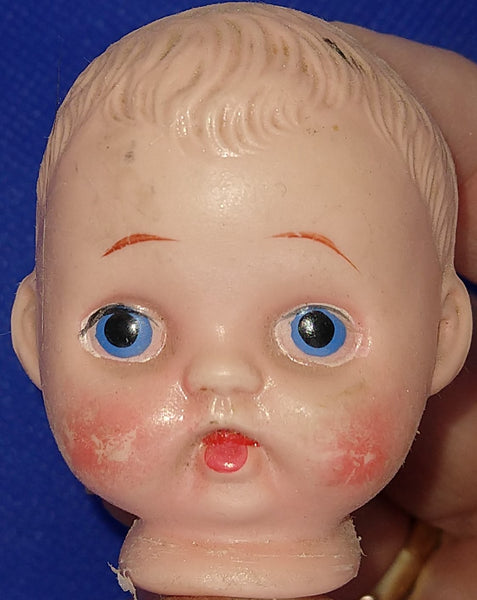 "Vintage plastic doll head 2"" x 1.5""  Original condition. Sold for parts only."