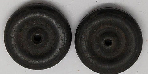 "Black rubber original 1-1/4"" solid wheel. 1/16th"" axle hole.  Set of two."
