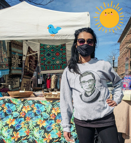 Woman at Eastern market wearing hero heads t-shirt