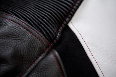 Polyester/cotton threads for skating leather suits