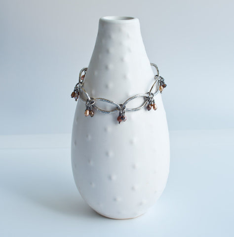 Fine silver link bracelet with fresh water pearls and swarovski crystals