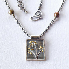 botanical necklace, silver and gold flower pendant