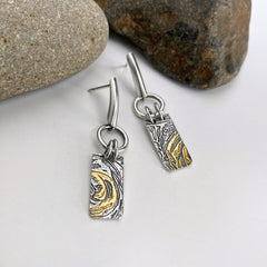 gold and silver post earrings with texture