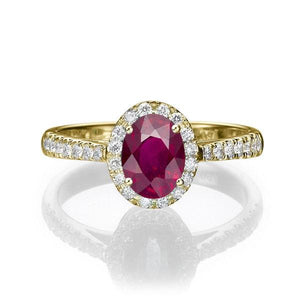 Oval Ruby and Diamond Halo Ring - Diamonds Mine